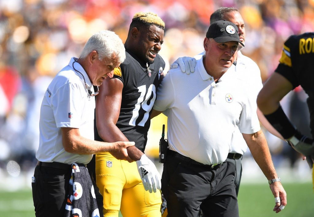 Juju Smith-Schuster of the Pittsburgh Steelers walks off the field due to injury against the Denver Broncos