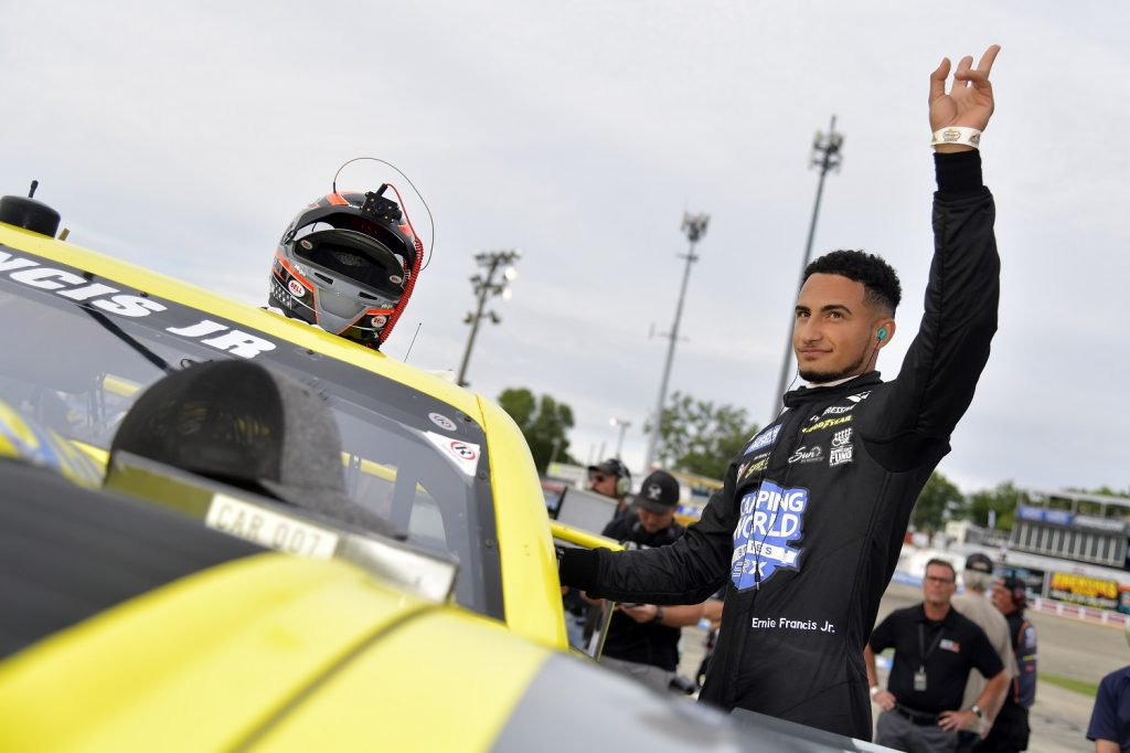 Ernie Francis Jr. waves to fans before climbing into his car during the Camping World Superstar Racing Experience event at Slinger Speedway on July 10, 2021. | Logan Riely/SRX via Getty Images